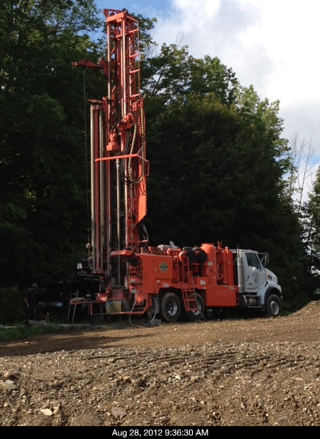 Well drilling rig being run by Randolph Well & Pump Co.