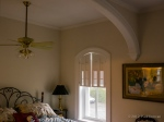Arch in bedroom matching curves of windows