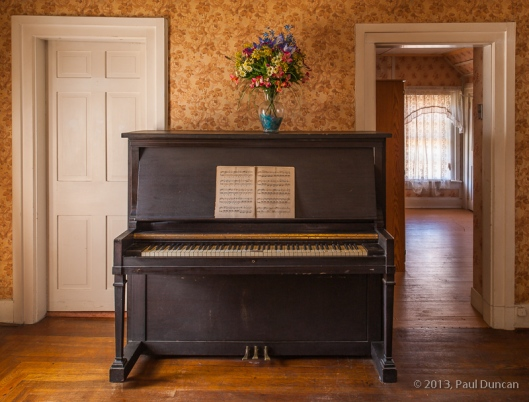 old upright piano in Victorian-era room