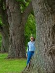 Lori stands among old Weeping Willows