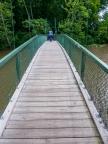 Lori heads over a footbridge