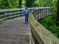 Lori on a boardwalk between footbridges