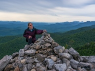 Lori tops off the cairn on summit of Bald Peak