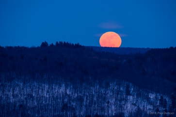 Winter full moon rising