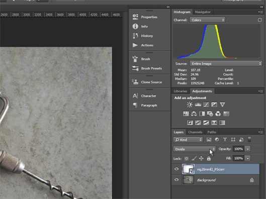 A Photoshop correction image layer uses the Divide blend mode to remove vignetting from the subject image.