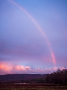 Before: sunset rainbow image with visible vignetting. Shot with Lumix 20mm lens at f/2.