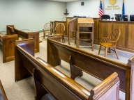 The courtroom is small, modest, but well-appointed.