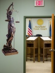 "Newfield town courtoom renovation: visitors are greeted by an image of Themis, ""Of Good Counsel"", at the door entering the courtroom."