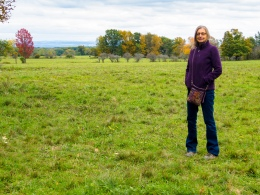 Lori in an open pasture at the north end of the Finger Lakes National Forest.
