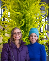 In front of Fern Green Tower by Dale Chihuly; lobby of Corning Museum of Glass.