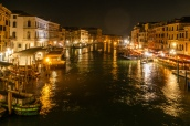 View along the Grand Canal from the Rialto Bridge at night.