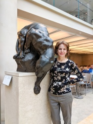 "Stella poses with ""Reaching Jaguar"" by Anna Hyatt Huntington. Señor Lopez of the Bronx Zoo was the real-life jaguar model for this sculpture."