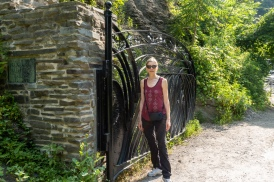 Lori at the 1200-pound ironwork gate, designed and fabricated by Durand Van Doren, at the lower end of the Cascadilla Gorge Trail.