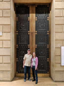 Rich and Lori in front of elevator doors.
