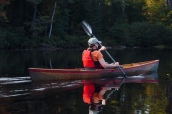 Lori paddles her Hornbeck canoe on Osgood Pond
